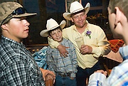 """NEWS&GUIDE PHOTO / PRICE CHAMBERS.Ryder's uncle Clay Heck keeps a firm grip on his nephew at the wedding of Kevin and Tammy Marshall on June 21 as they mingle with other guests. """"Right when he met Tammy I knew it was gonna happen but I'm happy for him,"""" Ryder said."""