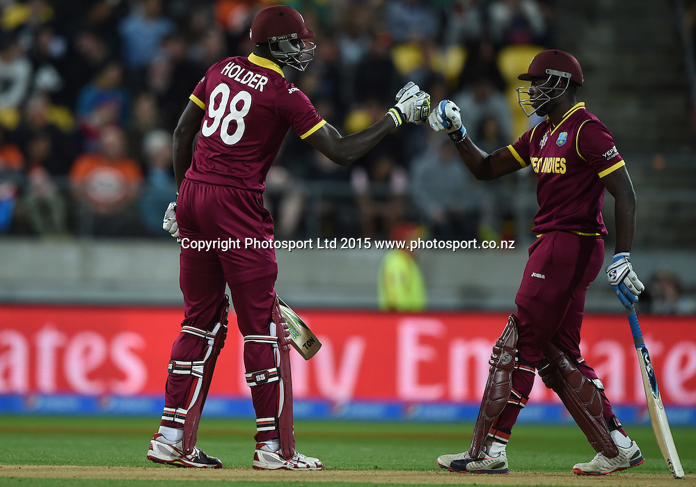 Jason Holder and Jonathan Carter during the ICC Cricket World Cup quarter final match between New Zealand Black Caps and the West Indies, Wellington, New Zealand. Saturday 21March 2015. Copyright Photo: Andrew Cornaga / www.Photosport.co.nz