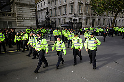 © Licensed to London News Pictures. 02/11/2017. London, UK. A large police presence guards the entrance to Downing Street as Israeli Prime Minister Benjamin Netanyahu arrives . Mr Netanyahu is holding bilateral talks with Foreign Secretary Boris Johnson and Prime Minister Theresa May in London today. Photo credit: London News Pictures