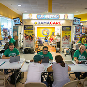 MIAMI, FLORIDA, NOVEMBER 16, 2016<br /> Customers at the mall kiosk of Sunshine Health and Life Advisors inside the Mall of the Americas in Miami Dade County. Customers have expressed concerns about &quot;Obama Care&quot; following the election of Donald Trump in the recent presidential elections.<br /> (Photo by Angel Valentin/Freelance)