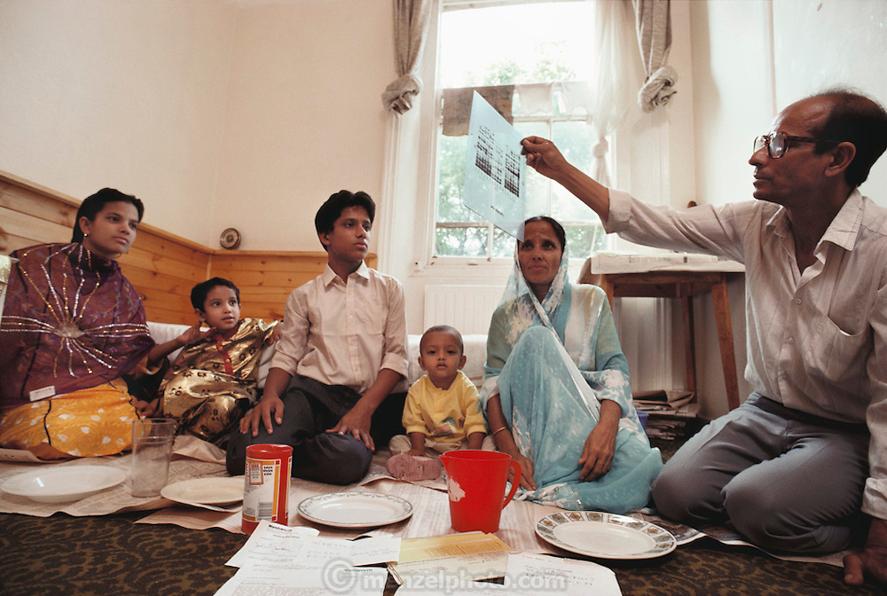 (1992) Abdul Matlib and his family from Bangladesh who were reunited in Britain after DNA testing proved blood relation. He is looking at the DNA autoradiogram that proved his blood relationships.  DNA consists of two sugar- phosphate backbones, arranged in a double helix, linked by nucleotide bases. There are 4 types of base; adenine (A), cytosine (C), guanine (G) and thymine (T). Sequences of these bases make up genes, which encode an organism's genetic information. The bands (black) on the autoradiograms show the sequence of bases in a sample of DNA. DNA Fingerprinting.