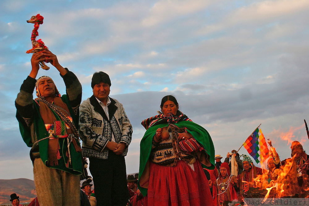 Bolivian President Evo Morales, center, looks on as a shaman raises a llama fetus to bless the Bolivian government in the sacred ruin city of Tiwanaku, some 72 kms (45 miles)  east of capital La Paz, Bolivia on Wednesday, Oct. 11, 2006. Indigenous leaders from Peru, Bolivia, Ecuador, Argentina, U.S. and Mexico gathered during a ceremony  of indigenous leaders from the American continent to bless Evo Morales.