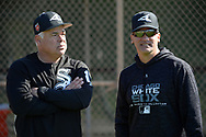 GLENDALE, ARIZONA - FEBRUARY 22:  Manager Rick Renteria #17 and Omar Vizquel #13 of the Chicago White Sox look on during a during spring training workout February 22, 2018 at Camelback Ranch in Glendale Arizona.  (Photo by Ron Vesely)  Subject:   Ricky Renteria; Omar Vizquel