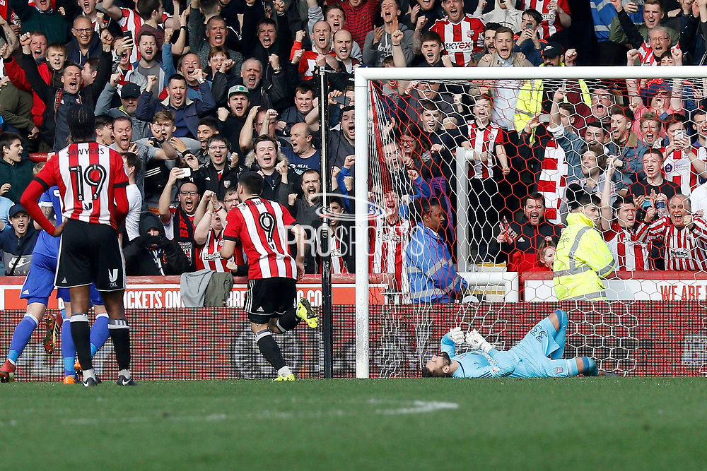 Brentford Forward Neal Maupay (9) scores a penalty and then heads off to celebrate (Score 1-0) during the EFL Sky Bet Championship match between Brentford and Ipswich Town at Griffin Park, London, England on 7 April 2018. Picture by Andy Walter.