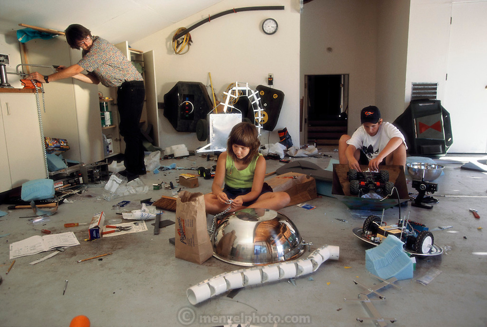 "In the East Bay suburb of Walnut Creek, near San Francisco, Will Wright and family collectively in their garage preparing their creation for ""Robot Wars""(daughter Cassidy 11, nephew Patrick 14, and Will). Later that week, in a battle pit ringed by six-foot sheets of bulletproof glass and a sellout crowd, radio-controlled gladiators battle their robots to the mechanical death. Will Wright developed the Sims software games."