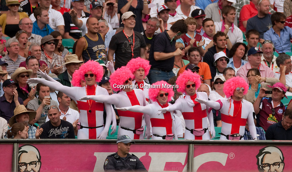 Visiting supporters signal another four during the fifth and final Ashes test match between Australia and England at the SCG in Sydney, Australia. Photo: Graham Morris (Tel: +44(0)20 8969 4192 Email: sales@cricketpix.com) 04/01/11