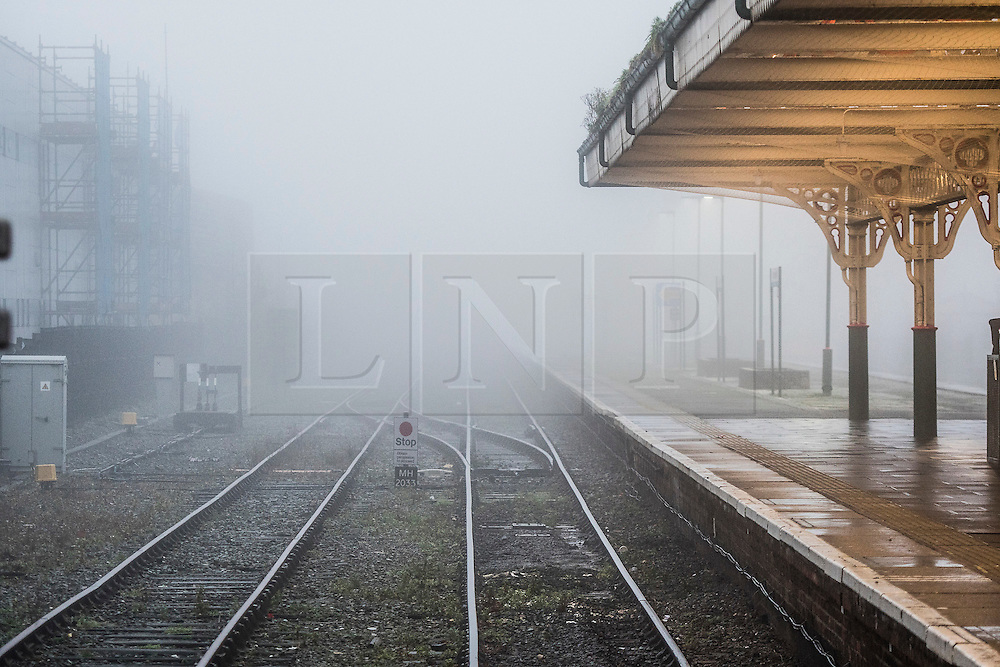 © London News Pictures. 08/01/2016. Aberystwyth, UK. Thick fog and and sea mist envelops the train lines at the railway station of  Aberystwyth seafront at the start of the day on Sunday 8 Jan 2016. The mild damp weather is set to change later in the week with a plume of cold northerly  air bringing snow to many areas. Keith Morris/LNP