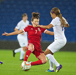 CARDIFF, WALES - Tuesday, August 21, 2014: Wales' Angharad James tackles England's Alex Scott during the FIFA Women's World Cup Canada 2015 Qualifying Group 6 match at the Cardiff City Stadium. (Pic by David Rawcliffe/Propaganda)
