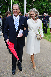 Michael Winner public memorial.  <br /> Sir Roger Moore with Kristina Tholstrup during the Memorial.<br /> Memorial takes place at the National Police Memorial. The film director and food critic helped establish, following his death on January 23 2013. <br /> Geraldine Winner, Sir Michael Parkinson, Sir Michael Caine, Sir Roger Moore, Cilla Black, Carol Vorderman, Sir Terence Conran, give eulogies, <br /> London, United Kingdom<br /> Sunday, 23rd June 2013<br /> Picture by Nils Jorgensen / i-Images