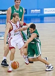 Sinan Guler of Turkey vs Jaka Lakovic (5) of Slovenia during the EuroBasket 2009 Group F match between Slovenia and Turkey, on September 16, 2009 in Arena Lodz, Hala Sportowa, Lodz, Poland.  (Photo by Vid Ponikvar / Sportida)