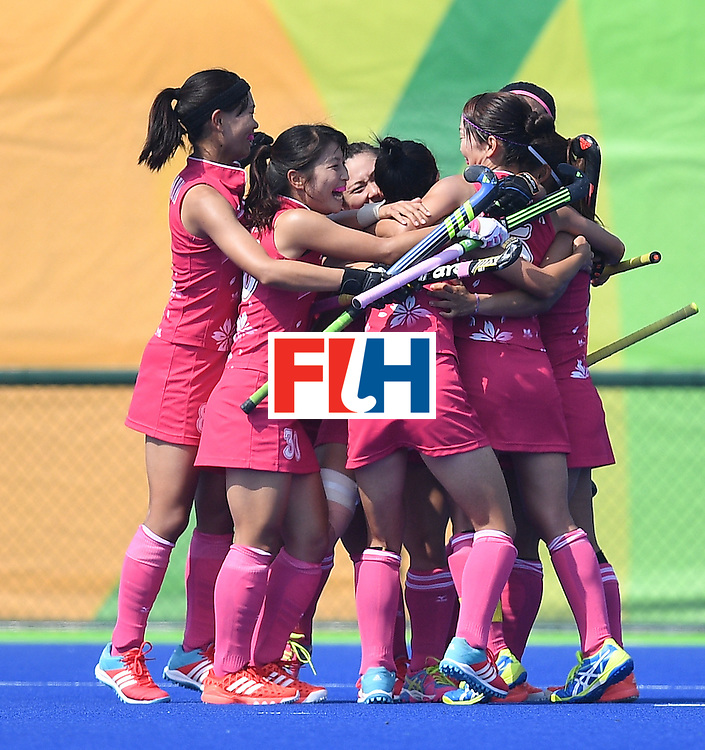 Japan's players celebrate scoring a goal during the women's field hockey Japan vs India match of the Rio 2016 Olympics Games at the Olympic Hockey Centre in Rio de Janeiro on August, 7 2016. / AFP / MANAN VATSYAYANA        (Photo credit should read MANAN VATSYAYANA/AFP/Getty Images)