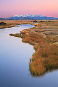 The Rio Grande (river) in the San Luis Valley of southern Colorado. In the distance is the Blanca Massif and Mount Blanca.