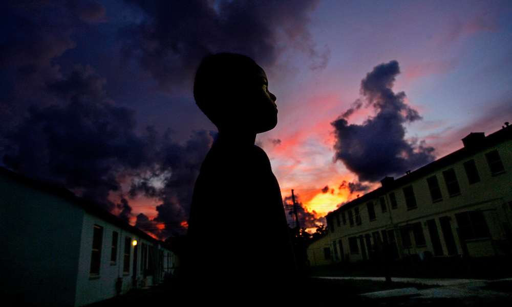 "(08/23/07 West Palm Beach)  As the sun sets Mario Frierson, 12, walks through the Dunbar Village housing project in West Palm Beach on the first day of school.  ""Mario is a natural born leader."" said Anthony DiMarzio Urban Youth Impact site coordinator.  (WILLIE J. ALLEN JR. 