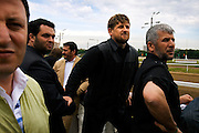 "Chechen President Ramzan Kadyrov attends a horse race in Moscow's Hippodrome. .Kadyrov's horse, ""Royal Quiet"", came first in the 1600-metre race. .The horse, born in the U.S.A., is parented by father: Real Quiet, mother: Dinasoar, is trained by S. G. Kolesnikov and rode by master jockey S. V. Petin."
