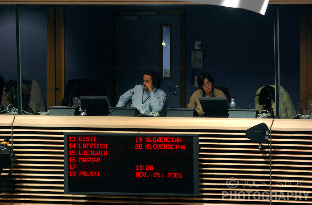 BRUSSELS, BELGIUM - NOV-29-2006 - Translators at the European Commission HQ, ply their trade during a press conference.  (PHOTO &copy; JOCK FISTICK)<br />
