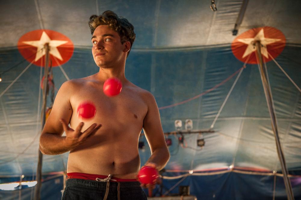Twenty three year old Italian juggler Daniel Reyes performs with the Flynn Creek Circus during a stop in Calistoga, California.