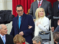 Aug 22, 2017 - Eugene, Oregon, U.S. - (File Photo) - Treasury Secretary Steve Mnuchin's wife Louise Linton apologized Tuesday after a backlash for an Instagram post for brand-name-dropping. PICTURED: January 20, 2017 - Washington, District of Columbia, United States of America - United States Secretary of the Treasury-designate STEVEN T. MNUCHIN and his fiancee LOUISE LINTON arrive for the swearing-in ceremony as Donald J. Trump is sworn-in as the 45th President of the United States on the West Front of the US Capitol on Friday. (Credit Image: © Ron Sachs/CNP via ZUMA Wire)