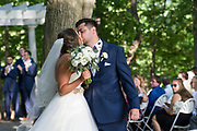 bride and groom kiss, outdoor ceremony by Tallmadge wedding photographer, Akron wedding photographer Mara Robinson Photography