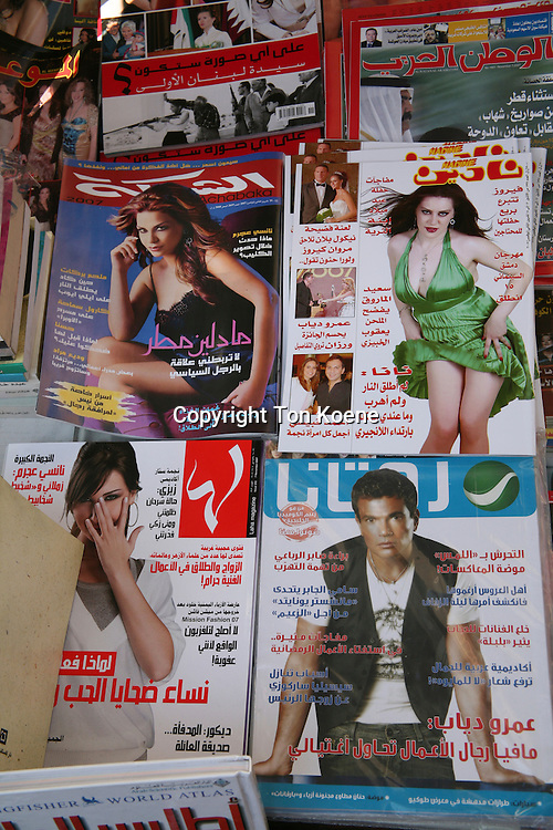 Fashion magazines and other media in Amman.