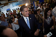 Republican presidential candidate Mitt Romney greets military veterans during a visit to the aircraft carrier USS Yorktown museum on October 6, 2011 in Charleston, South Carolina.