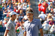 Indian Wells, CA - Roger Federer of Switzerland and Novak Djokovic of Serbia walk past each other during the final match in changeover at the BNP Paribas Open.