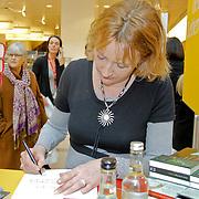 NLD/Amsterdam/20120310 - Feest der Letteren 2012 , Simone van der Vlugt signeert boek