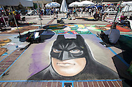Artists work on their pieces during during the Pasadena Chalk Festival on Paseo Colorado in Pasadena, California, June 16, 2013. More 600 artists using 25,000 sticks of pastel chalk to create life-size murals on the city pavement. This year's highlights include Animation Alley, spotlighting professional and amateur animators and graphic designers from Southern California.  (Photo by Ringo Chiu/PHOTOFORMULA.com)