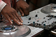 Hip Hop legend, Kurtis Blow, 47, mixing music during a Mass Service at the Hip Hop Church in Harlem, New York, NY., on Thursday, June 29, 2006. A new growing phenomenon in the United States, and in particular in its most multiethnic city, New York, the Hip Hop Church is the meeting point between Hip Hop and Christianity, a place where ?God? is worshipped not according to religious dogmatisms and rules, but where the ?Holy Spirit? is celebrated by the community through young, unique, passionate Hip Hop lyrics. Its mission is to present the Christian Gospel in a setting that appeals to both, those individuals who are confessed Christians, as well as those who are not regularly attending traditional Services, while helping many youngsters from underprivileged neighbourhoods to feel part of a community, to make them feel loved and to help them not to give up when problems arise. The Hip Hop Church is not only forward-thinking but it also has an important impact where life at times can be difficult and deceiving, and where young people can be easily influenced for the worst purposes. At the Hip Hop Church, members are encouraged to sing, dance and express themselves in any way that the ?Spirit of God? moves them. Honours to students who have overcome adversity, community leaders, church leaders and some of the unsung pioneers of Hip Hop are common at this Church. Here, Hip Hop is the culture, while Jesus is the centre. Services are being mainly in Harlem, where many African Americans live; although the Hip Hop Church is not exclusive and people from any ethnic group are happily accepted and involved with as much enthusiasm. Rev. Ferguson, one of its pioneer founders, has developed ?Hip-Hop Homiletics?, a preaching and worship technique designed to reach the children in their language and highlight their sensibilities, while bringing forth Christianity. This ?Keep It Real? evangelism style is the centrepiece of Rev. Ferguson?s ministry, one that speaks the plain language