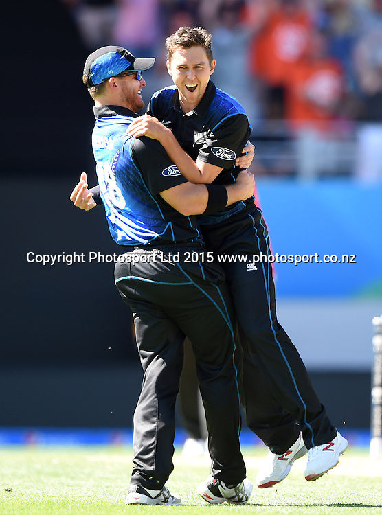 Corey Anderson and Trent Boult celebrate the wicket of Marsh during the ICC Cricket World Cup match between New Zealand and Australia at Eden Park in Auckland, New Zealand. Saturday 28 February 2015. Copyright Photo: Andrew Cornaga / www.Photosport.co.nz