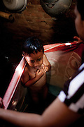 Fazril (5) prepares for school in the morning. Citeureup Village, Kabupaten Bandung...Credit: Andri Tambunan for Greenpeace