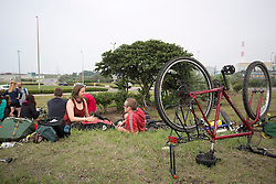 "© Licensed to London News Pictures. 30/08/2015. Calais, France.  Cyclist from ""Critical mass to Calais"" take some rest at their arrival to Calais from London as they are to donate bicycles to the people in the refugee camp, also known as the Jungle, as well as supplies to support the life at the site. Photo credit : Isabel Infantes/LNP"