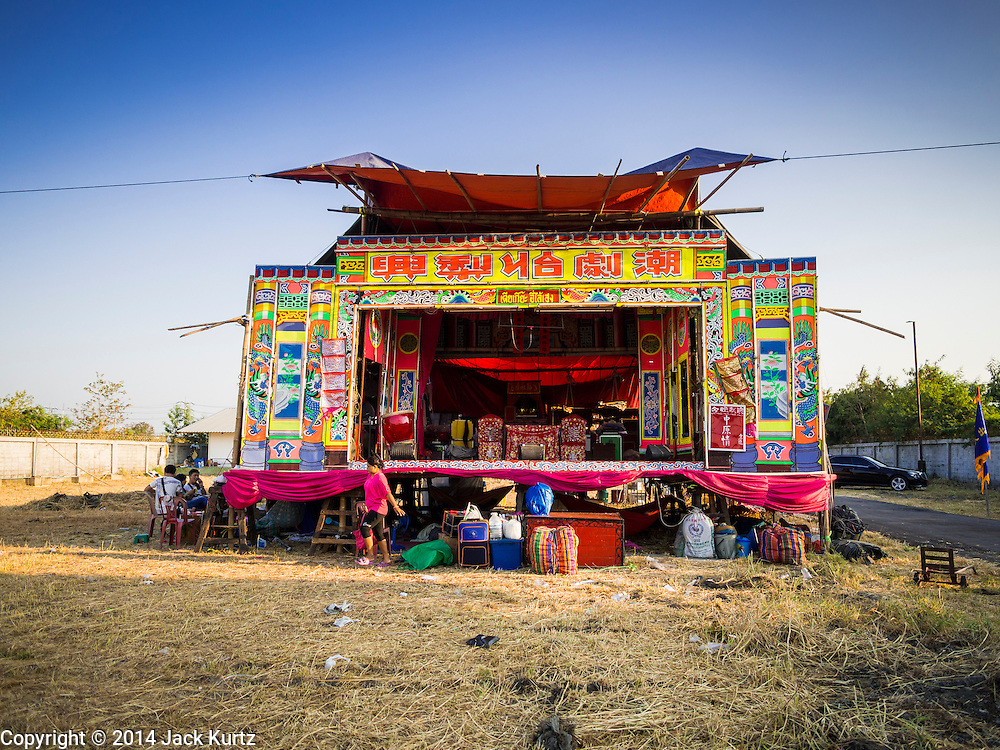 "28 JANUARY 2014 - BANGKOK, THAILAND: The stage for Tear Kia Ee Lye Heng opera troupe before a performance. They were performing for a business in the Min Buri district of Bangkok for the Lunar New Year, which this year is Jan 31. Chinese opera was once very popular in Thailand, where it is called ""Ngiew."" It is usually performed in the Teochew language. Millions of Teochew speaking Chinese emigrated to Thailand (then Siam) in the 18th and 19th centuries and brought their cultural practices with them. Recently the popularity of ngiew has faded as people turn to performances of opera on DVD or movies. There are still as many 30 Chinese opera troupes left in Bangkok and its environs. They are especially busy during Chinese New Year when they travel from Chinese temple to Chinese temple performing on stages they put up in streets near the temple, sometimes sleeping on hammocks they sling under their stage. They are also frequently hired by Chinese owned businesses to perform as a form of merit making.    PHOTO BY JACK KURTZ"