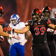 20 October 2018: San Diego State Aztecs linebacker's Ronley Lakalaka (39) and Troy Cassidy (42) celebrate after making a goal line stand in the first quarter. The Aztecs beat the Spartans 16-13 Saturday night at SDCCU Stadium.