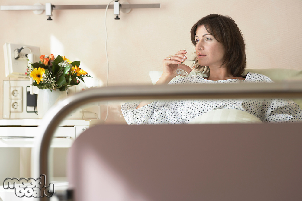 Patient Drinking Water in Hospital Bed