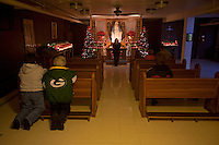 "CHAMPION, WI - DECEMBER 22:Visitors pray to the Blessed Virgin Mary in the site that is said to be the spot where Sister Adele Brise was visited on three occasions from the Blessed Virgin Mary in 1859 at the Shrine of Our Lady of Good Help, December 22, 2010 in Champion, Wisconsin. After years of research, the Bishop of Green Bay determined that the sightings of Mary ""clothed in dazzling white"" are indeed ""worthy of belief"" and now have now been officially sanctioned as real by the Vatican. This shrine is the first of such for the United States and now joins the company of Lourdes and Fatima.   (Darren Hauck )"