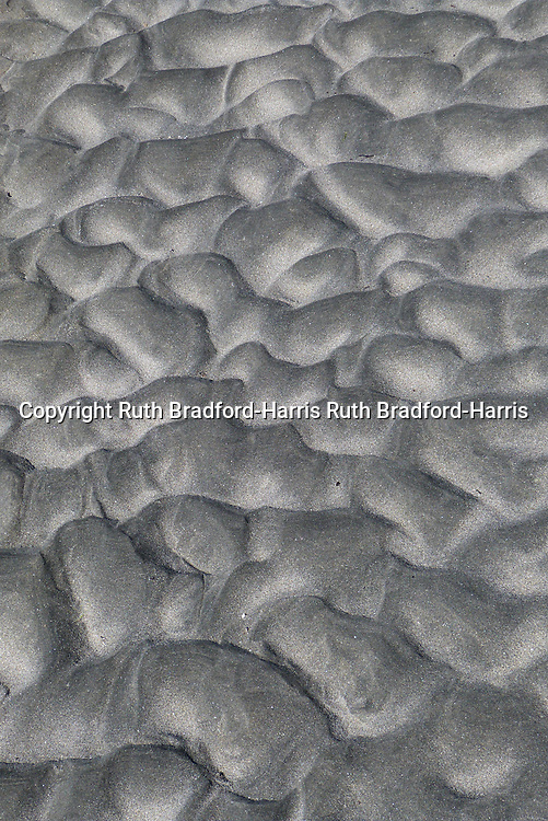 Pillow-like textures in the rippled sand on the beach at Camasunary, Isle of Skye at low tide.<br />