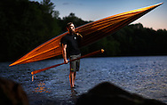 While away from his day job as an engineer for automotive giant Volvo, Will Oakley is able to focus on a different mode of transportation. Oakley spends his spare time carefully cutting, assembling and lacquering strips of wood into custom boats in the shop behind his Greensboro, N.C. home. Upon completion of a project, Will always enjoys testing his new vessel (be it a canoe or kayak) in one of the local Greensboro lakes, as he did here in Lake Brandt on Saturday, April 23, 2014, in Greensboro, N.C. JERRY WOLFORD and SCOTT MUTHERSBAUGH / Perfecta Visuals