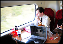 George Osborne Shadow Chancellor of the Exchequer on his mobile while on a train from Glasgow Station to Carlisle ,Thursday October 22, 2009 Picture by Andrew Parsons / i-Images