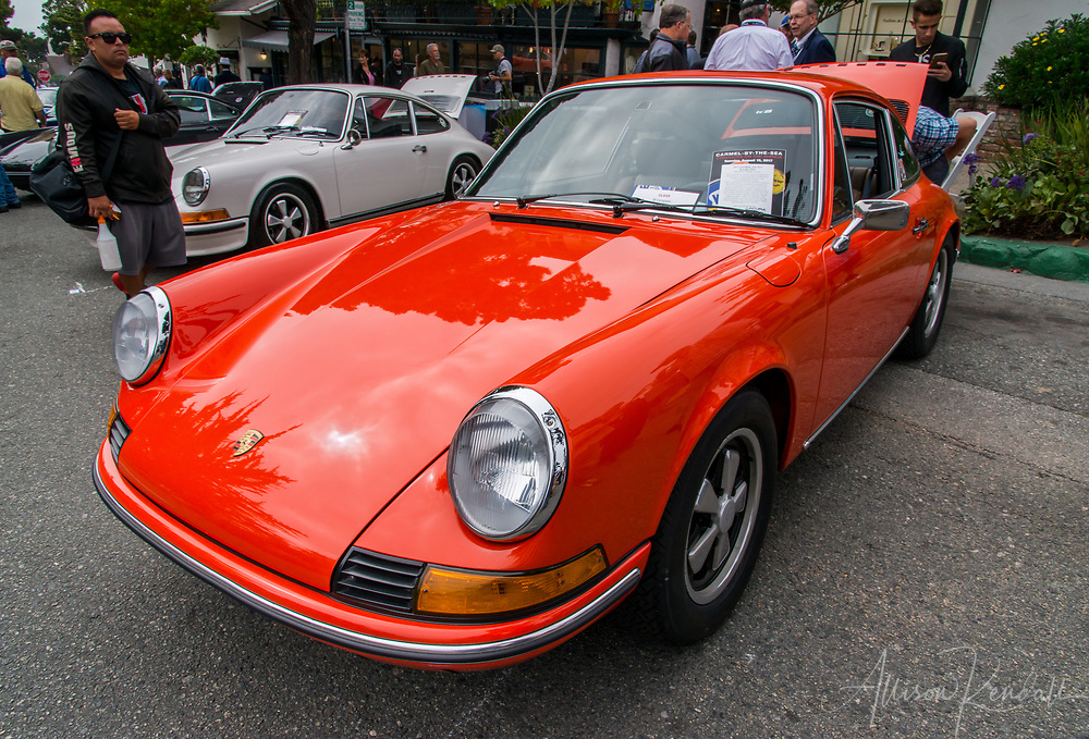 A bright orange Porsche 911 on display at the 2017 Carmel-by-the-Sea Concours on the Avenue