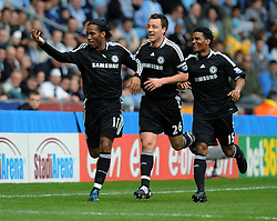 Didier Drogba celebrates scoring the first goal with team mates John Terry and Florent Malouda during the FA Cup Sponsored by E.ON 6th round match between Coventry City and Chelsea at the Ricoh Arena on March 7, 2009 in Coventry, England.