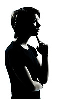 one caucasian young teenager silhouette boy or girl thinking portrait in studio cut out isolated on white background