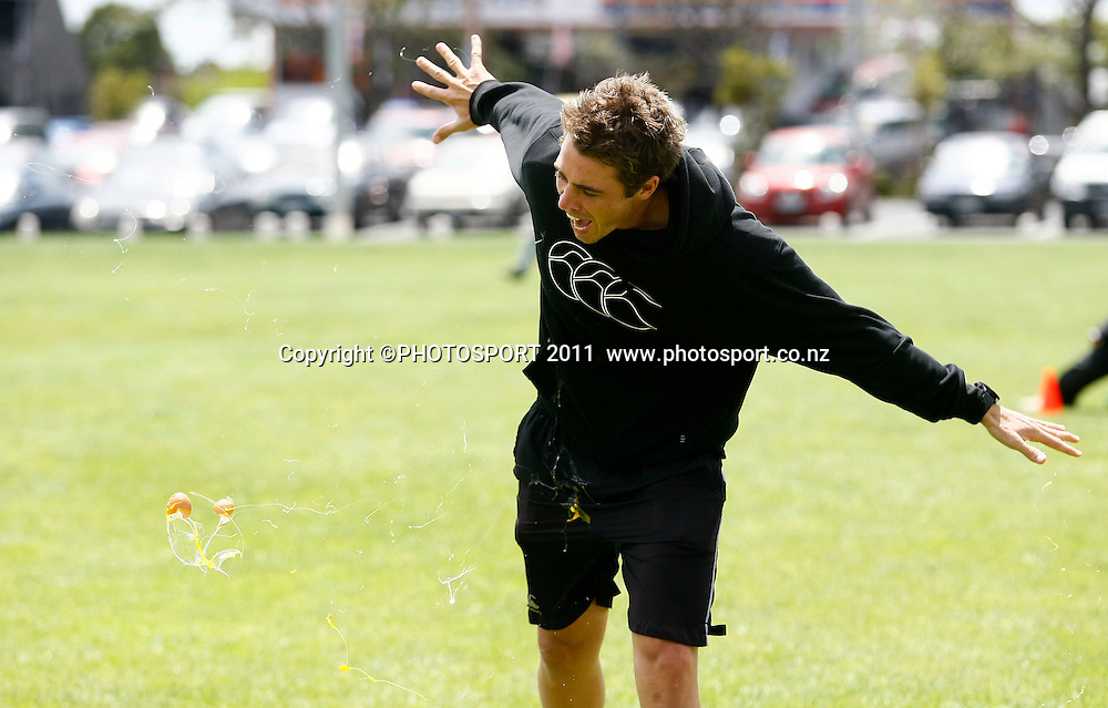 Tim Southee gets covered in egg after attempting a catch during the HRV Cup Cricket Blackcaps Day, Papatoetoe Recreation Centre, Auckland, 10 November 2011. Photo: Simon Watts / photosport.co.nz
