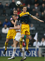 Photo: Steve Bond/Richard Lane Photography. MK Dons v Southampton. Coca-Cola Football League One. 20/03/2010. Aaron Wilbraham (C) is fouled by Dean Hammond (R)