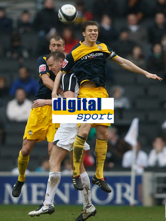 Photo: Steve Bond/Richard Lane Photography. MK Dons v Southampton. Coca-Cola Football League One. 20/03/2010. Aaron Wilbraham (C) is fouled by Dean Hammond (R)