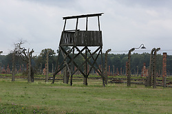 A guard tower with barbed wire fences at the Auschwitz-Birkenau Nazi concentration camps in Auschwitz, Poland on September 3, 2017. Auschwitz concentration camp was a network of German Nazi concentration camps and extermination camps built and operated by the Third Reich in Polish areas annexed by Nazi Germany during WWII. It consisted of Auschwitz I (the original camp), Auschwitz II–Birkenau (a combination concentration/extermination camp), Auschwitz II–Monowitz (a labor camp to staff an IG Farben factory), and 45 satellite camps. In September 1941, Auschwitz II–Birkenau went on to become a major site of the Nazi Final Solution to the Jewish Question. From early 1942 until late 1944, transport trains delivered Jews to the camp's gas chambers from all over German-occupied Europe, where they were killed en masse with the pesticide Zyklon B. An estimated 1.3 million people were sent to the camp, of whom at least 1.1 million died. Around 90 percent of those killed were Jewish; approximately 1 in 6 Jews killed in the Holocaust died at the camp. Others deported to Auschwitz included 150,000 Poles, 23,000 Romani and Sinti, 15,000 Soviet prisoners of war, 400 Jehovah's Witnesses, and tens of thousands of others of diverse nationalities, including an unknown number of homosexuals. Many of those not killed in the gas chambers died of starvation, forced labor, infectious diseases, individual executions, and medical experiments. In 1947, Poland founded a museum on the site of Auschwitz I and II, and in 1979, it was named a UNESCO World Heritage Site. Photo by Somer/ABACAPRESS.COM