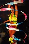 Podium dancer, dancing with multi-coloured streamer, UK, 2000