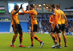 Jordan Graham ( 2nd  L ) of Wolverhampton Wanderers celebrates with team mates after his cross is turned in for an own goal by Connor Goldson ( not pictured ) of Brighton and Hove Albion to make it 1-0 - Mandatory byline: Paul Terry/JMP - 07966 386802 - 01/01/2016 - FOOTBALL - Falmer Stadium - Brighton, England - Brighton v Wolves - Sky Bet Championship