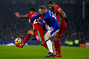 Swansea City defender Kyle Naughton (26) get away from Everton striker Wayne Rooney (10)  during the Premier League match between Everton and Swansea City at Goodison Park, Liverpool, England on 18 December 2017. Photo by Simon Davies.