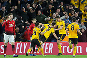 GOAL - Wolverhampton Wanderers forward Raul Jimenez (9) celebrates with Wolverhampton Wanderers midfielder Joao Moutinho (28) and Wolverhampton Wanderers defender Matt Doherty (2) 1-0 during the The FA Cup match between Wolverhampton Wanderers and Manchester United at Molineux, Wolverhampton, England on 16 March 2019.