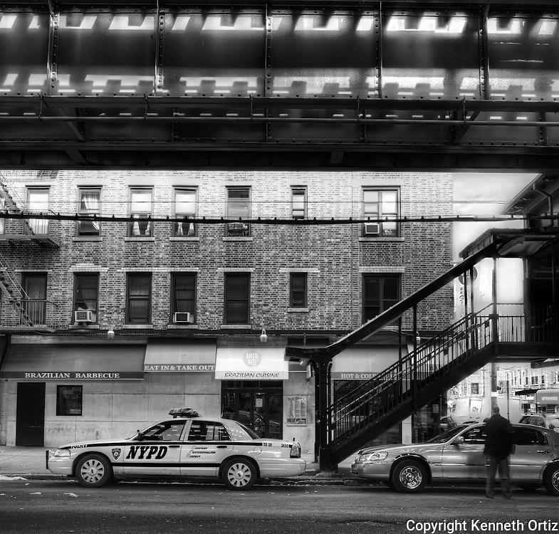 This is a view under the elevated train station on the N & W line in Queens New York. The particular stop is the Broadway station on the N & W line.